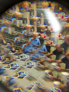 Erik Kissa commenting on work at a members' meeting. Danny Schweers photo using a plastic toy lens with his iPhone.